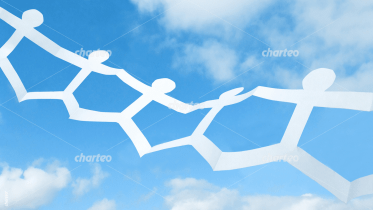 Papercut human chain in front of blue sky