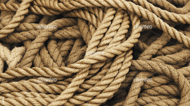 Loose pile of brown marine ropes