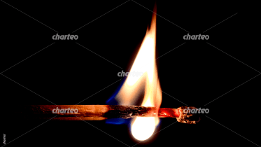 Burning matchstick with blazing flame