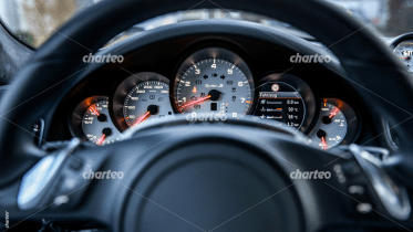 Dash board viewed through steering wheel of car