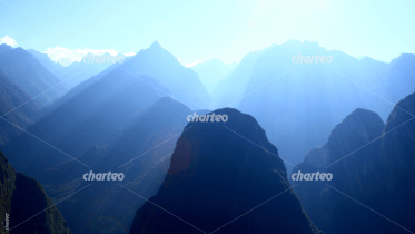 Landscape photo of alpine mountain ranges in sunlight