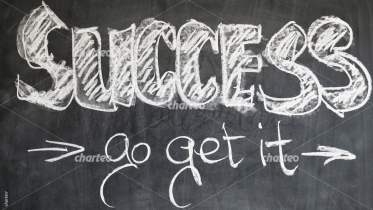 "Chalk drawing of the word ""success"" on blackboard"