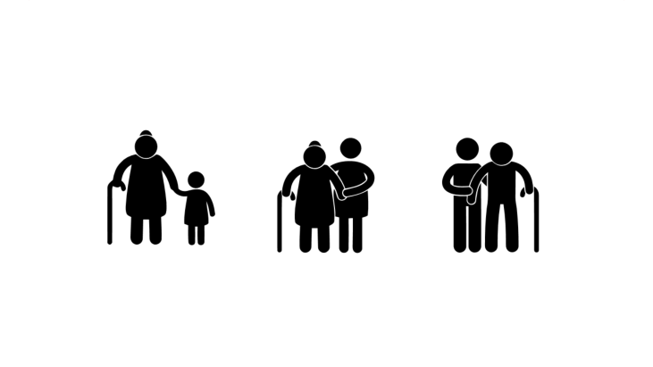 Grandparents with walking cane supported by family members
