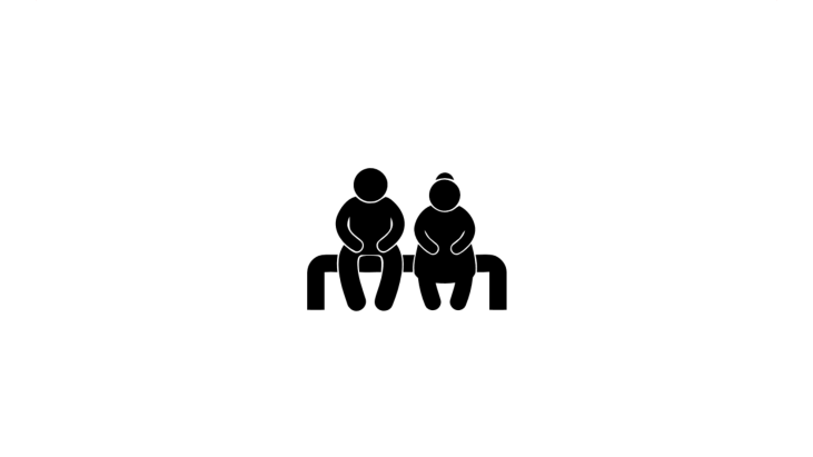 Two Elderly People Sitting On A Park Bench