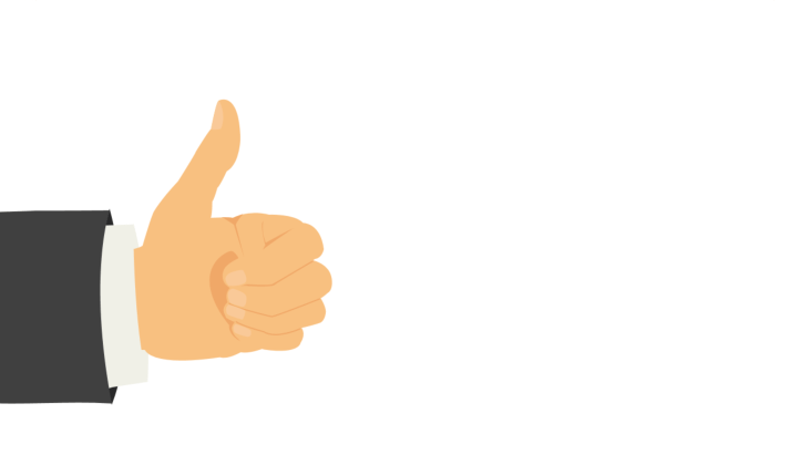 Businessman's hand making thumbs up gesture