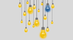 Several yellow hanging lightbulbs and one blue lightbulb