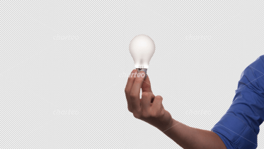 Single hand holding light bulb
