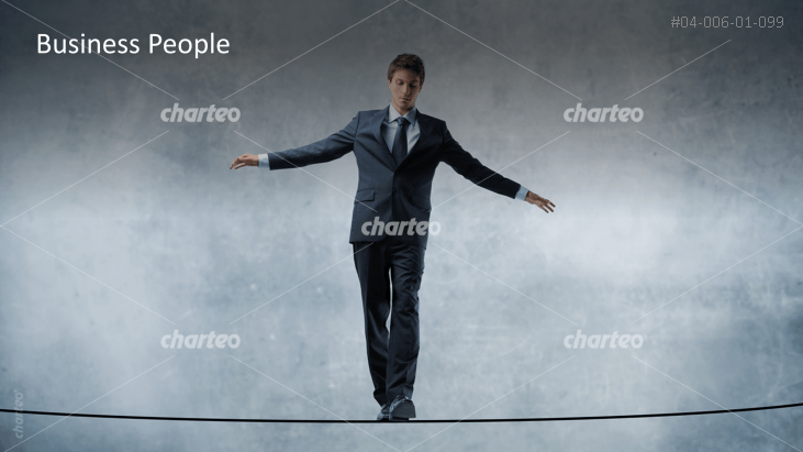 Business People - Man balancing on rope
