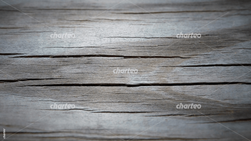 Horizontal grey wooden plank with age ring