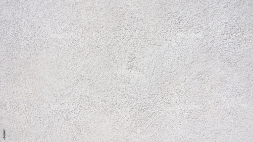 White rough-cast facade on exterior wall