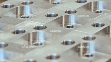 Steel plate with several threaded holes
