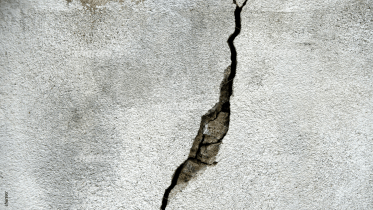 Grey concrete wall with a crack