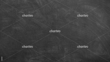 Empty black chalk board with chalk traces