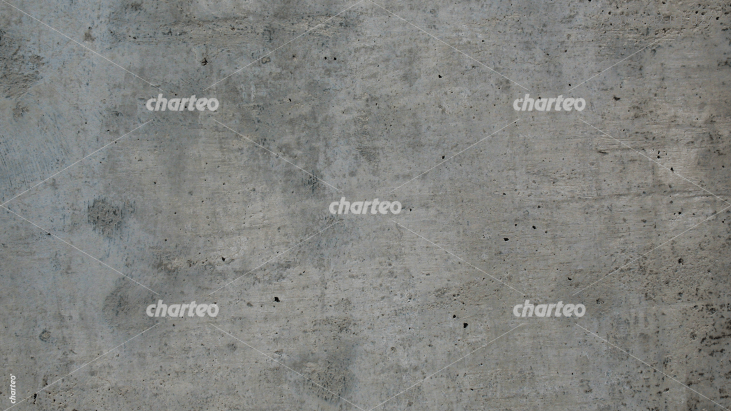 Grey exposed concrete wall with holes